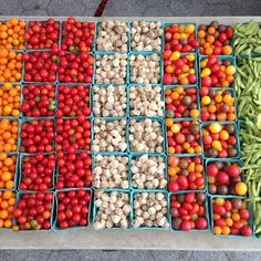 Vegetable art! #tomatoes #huskcherries #snappeas on display at Union Square Greenmarket in #Manhattan - text SoGood to 877877 for a #farmersmarketnyc near you!