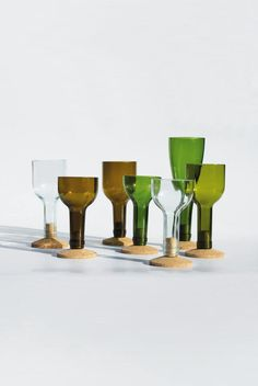 Glasses made hand-cut wine bottles with a cork bottom with also serves as a built in coaster.