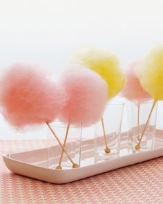 Cotton Candy Centerpieces - Skip the floral centerpieces and top your kids' table with in-palette cotton candy, which can double as dessert. For an extra-sweet surprise, swirl the delicious fluff balls around sticks of rock candy.