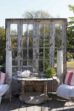 Great way to use old French doors and columns!  We should do this on our deck.  We have the columns ... just need to find the doors.