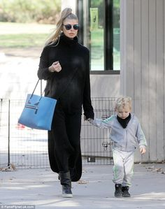 Back in black: Busy mom Fergie was decked out completely in black for her recreational outing with her two-year-old son Axl on Thursday in Los Angeles