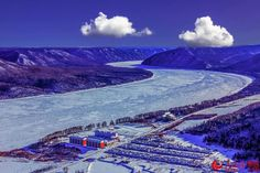 Astounding photo captures the winter of Longjiang ('Dragon River') Three Gorges in Luobei County, northeast #China's #Heilongjiang province. #season #ice #icy #blue #clouds #clean #pure #nature #view