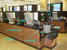 In this UWM laboratory, the sink, lab bench top, and center console top and front panels are stone or pressboard; however, the console vertical column supports and sink drain boards are asbestos transite.