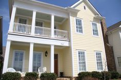 Gorgeous 2 story porch on this amazing home in the Northshore Town Center