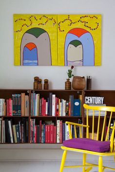 One option I've considered is low bookshelves along my living room wall, which is in need of a console table anyway.