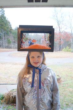 Crazy Hat Day......she s wearing a fish tank hat d552da3014bc