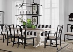 Back To Black And White Dining Room  Step up to elegance! Our stately double pedestal table sets the tone for an uptown, upscale, and utterly delightful dining space. A simple black-and-white palette is the backdrop for an array of stunning silhouettes: the table's baluster base, a bold cage chandelier, and the urn-shaped splats of our refreshed Chippendale chairs.