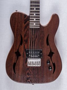 Tele f-hole, wenge top and bottom, iroko frame, walnut neck and rosewood freetboard! SD Jazz@bridge position!