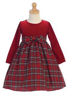 Girl Dress Style C503 - RED Long Sleeve Velvet Plaid Dress  Bring in the festivities in this super adorable dress. Plaid styles will forever be in style which is why this is one of our favorite dresses. The long sleeve bodice is made of velvet and features the cutest three dimensional flower.  http://www.flowergirldressforless.com/mm5/merchant.mvc?Screen=PROD&Product_Code=L_C503&Store_Code=Flower-Girl&Category_Code=Red