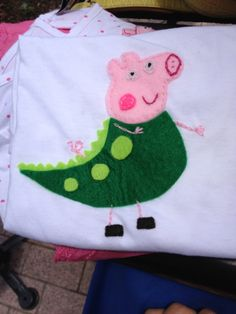 T-shirt felt appliqué - George the dinosaur from Peppa Pig. I made these for my kids and me to go to a Peppa Pig themed birthday.