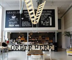 Wolters Dutch designer Bertjan Pot combined a safety step ladder with carnival lights to create a disco industrial vibe at the Grand Cafe Wenneker in Holland. Industrial Light and Magic: A Disco-Inspired Cafe in Holland. Cafe Industrial, Industrial Lighting, Industrial Bedroom, Industrial Furniture, Industrial Closet, Industrial Restaurant, Industrial Farmhouse, Industrial Style, Industrial Wallpaper