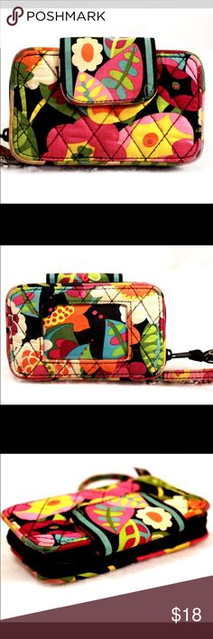 "VERA BRADLEY Black and Floral Wristlet VERA BRADLEY Black and Floral Wristlet. It has a compartment that can hold either a phone (can fit an iPhone 6 but not 6 Plus), or it can hold other items as it has a snap closure. It has a coin pouch with zip closure, three card slots and two bigger sleeves.No stains, holes, or snags.Some overall light wear due to prior usage, but in very nice pre-owned condition.  Measures 5.7x4x1.25"" with 6"" strap drop.  Orig. $48.00. Vera Bradley Bags Wallets"
