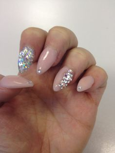 Pretty pink almond nails with sparkles!