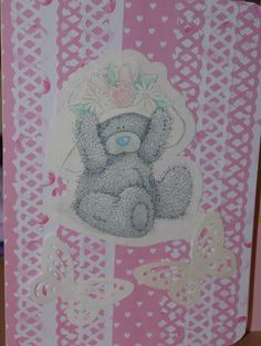 Tatty Teddy on a pink and white lacy background