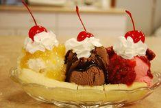 Sundae ~ 1 banana, 1 scoop (2oz) of chocolate, strawberry, and vanilla ice cream, Strawberries, Pineapple, Chocolate Sauce, chopped nuts, whipped cream and a cherry