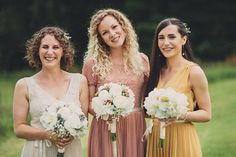 mismatched bridesmaids - love the vintage hues but would replace the pale/white with a sage green.