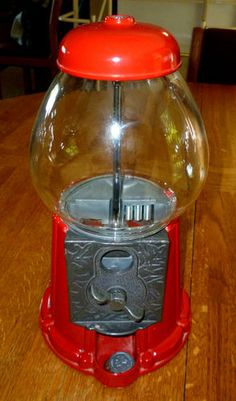 OMG Cool! Vintage Jolly Good Red Gumball Machine w/ Glass Globe MINT Cond Circa Mid 80s - bids begin at only $64.00. This would look great on  the counter of a candy store, retro soda fountain counter, or ole timey country style diner. Grab it!