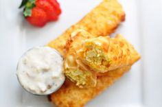 Scrambled Egg & Cheese Egg Rolls with Sausage Gravy #Recipe by Divian Connor