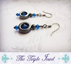 Got a pair of these from her, but with purple instead. <3  Blue Bicone Swarovski Crystal and Hematite Loop Beaded Earrings - $14