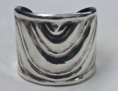 I am most pleased to offer this wonderful cuff bracelet for your consideration. It is truly exquisite! It is quite heavy, weighing 101 grams of FINE