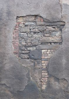 Masonry: sandstone; brick; cement render.