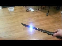A double bladed sword with a stun gun built in!  It is insulated in rubber padding and wraped in electrical tape.  I did get the idea from gadgetguru, but i put it into practice and made it my own.