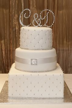 bling wedding cake I like the quilted look and the diamontes around each tier. LOVE