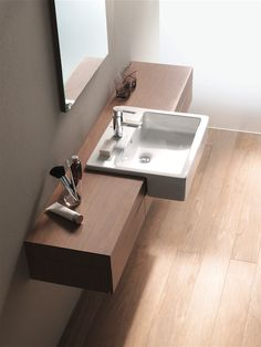 Semi-recessed basin  Fitted into a cabinet with only the front part of the basin protruding, a semi-recessed basin is carefully crafted to fit into ledges or shelves, making it look like a continuous part of the bathroom furniture. They can come in different shapes and designs, with rounded or angular edges. They're ideal for any stylish, modern bathroom and can create a seamless look when incorporated perfectly with the design of your cabinetry.