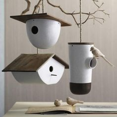 Bodega bird houses by Roost are made from matte-glazed stoneware, a recycled teak rooftop, a rope, and stainless steel hardware