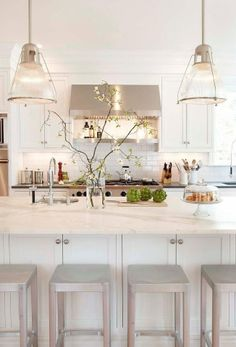 Extra cabinets would be a must under our breakfast bar-also love the shelf over stove