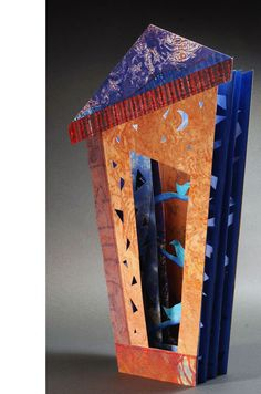 "Pajaros Azules II by Luz Marina Ruiz. 2009. One-of-a-Kind. 4.5 x 8"". Tunnel book structure. Collograph with watercolor."