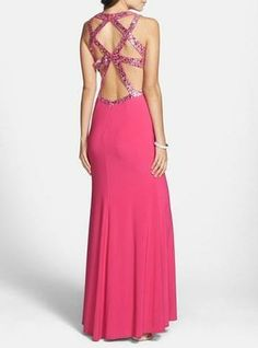 Bold yet elegant. Pink sequin cutout prom dress.