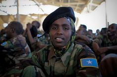 A female soldier of the Somali National Army (SNA) sits during a passing-out ceremony 17 March 2012 marking the conclusion of a 10-week advanced training course conducted by the military component of the African Union Mission in Somalia (AMISOM).  AU-UN IST PHOTO / STUART PRICE.
