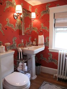Powder room with wild wallpaper