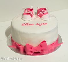 Christening cake with pink fondant shoes and bowl. www.tekila.fi
