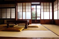 tatami room with shoji screens, pillows for seats, optically and functionally the weight is collected low, although the house itself is a bit higher