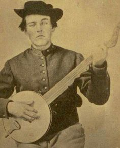 Civil War soldier holding a Sweeney style banjo.
