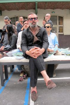 """Robert Rabensteiner following his style tip, """"be yourself,"""" in pajama shirt and slippers with suit"""