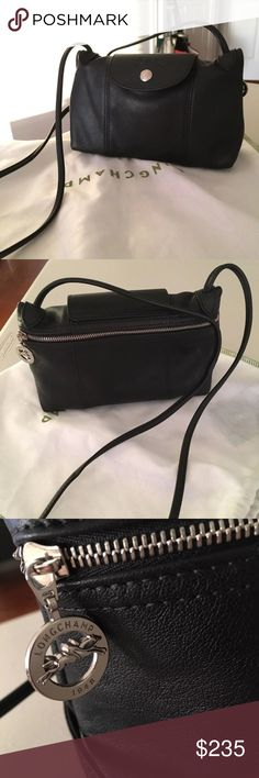 """Longchamp cuir crossbody 8.75"""" x 5.5"""" x 2.85"""". Color: Black. Crossbody mini bag from Longchamp Le Pliage Cuir collection. Small exterior front pocket with snap closure. Final sale. Final price. Longchamp Bags Crossbody Bags"""