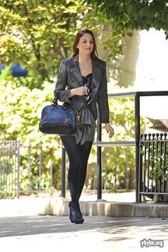 I love this being a little less safe than usual, she looks sexy. I litteraly DIE for those Baleciaga shoes.    Milly blouse.  Tibi skirt and jacket.  Louis Vuitton bag.  Balenciaga shoes.