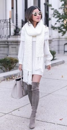 For the girly girls out there, there is brilliant winter white to make a classy statement in the chilly temperatures. Over-the-knee suede boots give it that must-have cool factor. #winteroutfits #winter #outfits