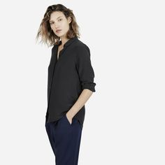 Our classic silk—polished and simple with a round collar  100% silk Fabric is a washed crepe-de-chine that shows a subtle lustre on darker colors Features traditional shoulder seams and an exposed button placket Dry clean only
