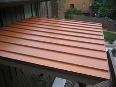 Metal slanted roof idea for porch - click on the picture to see the step by step pictures and what the underside (ceiling) looks like. Has good tips!