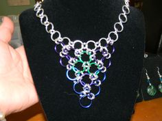 Multi Color Chain Mail Necklace 21. $14.99, via Etsy. Unique Handcrafted Jewelry created by me. :)  Created from beads, wire, ribbon, and charms.  <3  Creative, interesting, and fun to wear!