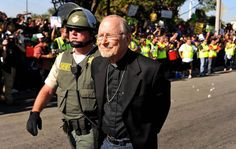 Retired pastor Bill Miller arrested for sitting in the street at a Walmart protest on black friday