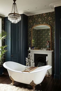 Gold and White Clawfoot Tub in Navy and Green Wallpapered Bathroom
