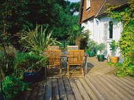 Decking boards are grooved to reduce slipperiness on a deck in wet weather. Decks are an option for a garden design where otherwise there is no usable space. It can be tied to a building or a freestanding surfacing material.