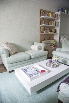 The back wall in the living room features Quadrille Fabrics wallpaper (San Marco Reverse in French Green on Off-White).