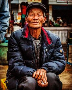 From the weekly market in Fuling China. What kind of stories much lie behind those eyes? Unfortunately language and cultural barriers make it very difficult for me to learn. Instead I'll settle for a few photographs.  Worth a thousand words?