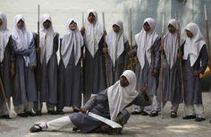 A Muslim schoolgirl from St. Maaz high school practises Vietnam Vovinam martial arts. REUTERS/Krishnendu Halder